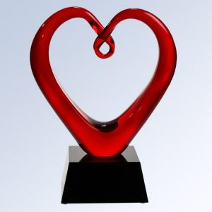 "Glass heart with red colored glass, mounted on a black glass base, G1610 is 9"" tall, weighs 5.2 lbs."